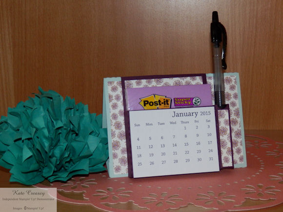 Post it note holder with pen and calendar